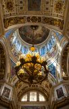 Saint Petersburg, Russia. Arched ceiling with windows and chandelier under the central dome of St Isaac Cathedral royalty free stock image