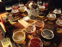 Assorted Beers in a Flight Ready for Tasting. Saint Petersburg, Russia - August 6, 2018: Assorted Beers in a Flight Ready for Tasting stock photos