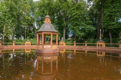 Menagerie pond. SAINT PETERSBURG, RUSSIA - AUGUST 18, 2017: Bosket `Menagerie pond` 1720, according to the drawings of Jan Roosen; restored in 2011 in the Summer Stock Photos