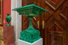 The malachite vase. SAINT PETERSBURG, RUSSIA - AUGUST 18, 2017: The malachite vase in the interior of State Hermitage in St.Petersburg, Russia. State Hermitage royalty free stock photography