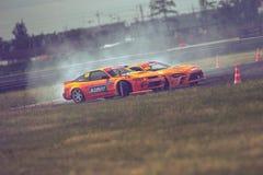 Saint-Petersburg, Russia - August 15, 2018: Powerful race car drifting on speed track Stock Photos