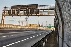 Expressway road with traffic barrier and road sign stock photos