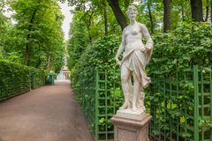 Park paths. SAINT PETERSBURG, RUSSIA - AUGUST 18, 2017: the Sculpture of the Summer garden. The park is one of the oldest in Saint Petersburg, it was designed by Royalty Free Stock Images