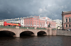 Saint-Petersburg. Russia. City Tour Bus on The Anichkov Bridge. SAINT - PETERSBURG, RUSSIA - SEPTEMBER 5, 2016: Hop-On Hop-Off. City Tour Bus rides on The Stock Images