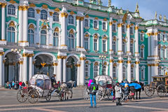 Saint-Petersburg. Russia. Coaches on the Palace Square Stock Photo