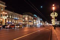 Nevsky Prospect at night. Saint-Petersburg, Russia - December 27, 2015: Nevsky Prospect at night with Christmas illumination, ordinary people walk on the street Stock Image