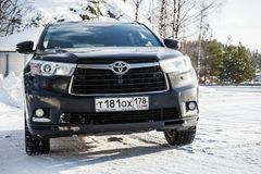 Black Toyota Highlander car in winter. Saint-Petersburg, Russia - February 25, 2018: Black Toyota Highlander car stands on a roadside in winter season,  front Royalty Free Stock Photos