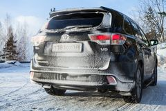 Black Toyota Highlander car, rear view. Saint-Petersburg, Russia - February 25, 2018: Black Toyota Highlander car stands on a roadside in winter season,  rear Royalty Free Stock Image