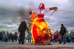 Saint-Petersburg, Russia - February 22, 2015: Feast Maslenitsa on Vasilyevsky Island. Burning doll - a doll set fire to the organizers. Flame lights up on the stock image