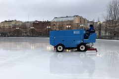 Ice combine refreshes ice on an open skating rink on the artificial island of New Holland in St. Petersburg stock photo