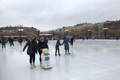 People skate on the open ice rink on the artificial island of New Holland stock photography