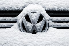 Saint-Petersburg, Russia - January 26, 2018: Close-up of a volkswagen chrome logo on a front grid covered with snow stock image