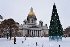 Grandma about St. Isaac's Cathedral and Christmas tree on a clou royalty free stock images