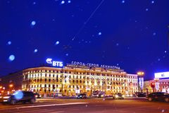 Saint-Petersburg, Russia - January 4, 2016: Winter night in Saint-Petersburg. Heavy snowstorm. Bokeh lights on the image of flying snowflakes in the air. Text Stock Images