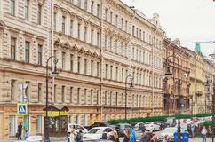 Beautiful historical architecture of St. Petersburg. People and cars on the streets. stock photography
