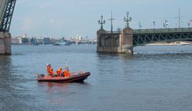 SAINT-PETERSBURG, RUSSIA - JULY 20, 2017: Boat rescue service in front of a divorced bridge in St. Petersburg, Russia. Boat rescue service in front of a divorced Royalty Free Stock Image