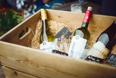 Bottles of wine in a vintage wooden box. Scenery showcases street cafe. Saint Petersburg, RUSSIA - July 09, 2018: Bottles of wine in a vintage wooden box stock photo