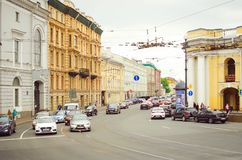 Cars drive on Nevsky Prospect in the city of St. Petersburg stock photo