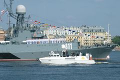 The command of the ship `Kazanets` welcomes the boat with the President of the Russian Federation V.V. Putin. SAINT-PETERSBURG, RUSSIA - JULY 29, 2018: The royalty free stock photo