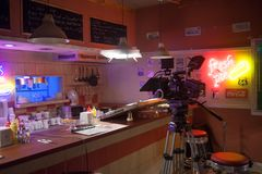SAINT PETERSBURG, RUSSIA - JULY 22, 2017: Film Crew On Location. 4K Camera Cinematographer. Filmmaking. Set, scenery of. The roadside cafe 80`s style Stock Photos