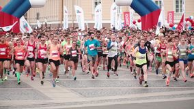 Saint Petersburg Russia, July 9 2017 - Start of a big city marathon. Large crowd of professional runners slow motion. stock video footage