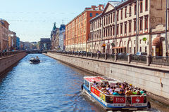 SAINT PETERSBURG, RUSSIA - JULY 26, 2014:  A tour boat with tour Stock Image