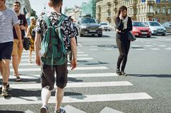 TPeople cross the road at a pedestrian crossing royalty free stock images
