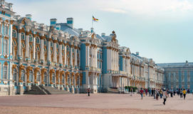 Saint-Petersburg, Russia - June 26, 2016: The main facade of the Catherine Palace in Tsarskoye Selo. Tourists. Sightseeing. On the roof of the royal flag is Stock Photos