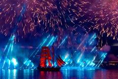 Saint-Petersburg, Russia-June 23,2018 Swedish brig Tre Krunur on. The annual celebration school graduates Scarlet Sails in St. Petersburg. Festive fireworks and stock images