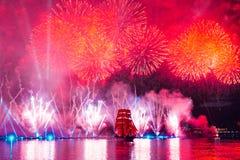 Saint-Petersburg, Russia-June 23,2018 Swedish brig Tre Krunur on. The annual celebration school graduates Scarlet Sails in St. Petersburg. Festive fireworks and stock photos