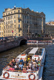 Saint Petersburg, Russia - June 17, 2017: Tourist boat moves along the Moika river. Nearby is the Hermitage. Royalty Free Stock Photo