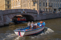 Saint Petersburg, Russia - June 17, 2017: Tourist boat moves along the Moika river. Nearby is the Hermitage. Stock Photo