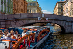 Saint Petersburg, Russia - June 17, 2017: Tourist boat moves along the Winter Canal near the Hermitage. Stock Photography