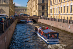 Saint Petersburg, Russia - June 17, 2017: Tourist boat moves along the Winter Canal near the Hermitage. Stock Images
