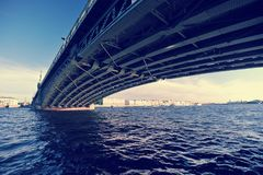 View of the Troitsky bridge with the waters of the river Neva in. Saint Petersburg, Russia - June 29, 2017: a view of the Troitsky bridge with the waters of the Stock Images