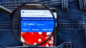 Agilent website homepage. Agilent logo visible on on the smartphone display. Saint Petersburg, RUSSIA - 29 March, 2019: Agilent website homepage. Agilent logo stock photos