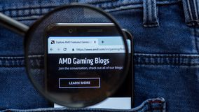 AMD website homepage. AMD logo visible on on the smartphone display. Saint Petersburg, RUSSIA - 29 March, 2019: AMD website homepage. AMD logo visible on on the stock photography