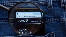 AMD website homepage. AMD logo visible on on the smartphone display. Saint Petersburg, RUSSIA - 29 March, 2019: AMD website homepage. AMD logo visible on on the royalty free stock photos