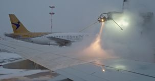 Saint-Petersburg Russia, 03 March 2019: Anti-icing before flight. Preparing airliner for winter flight in Pulkovo. Saint-Petersburg Russia, 03 March 2019: Anti stock video footage