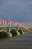 SAINT PETERSBURG, RUSSIA - MAY10, 2014: Bascule Trinity Troitsky Bridge across the Neva river with tricolor flags Stock Image
