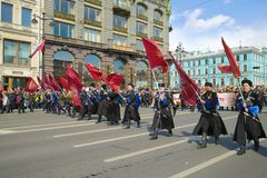Cossacks with flags open the procession of the `Immortal Regiment`. Victory Day in St. Petersburg Royalty Free Stock Photo