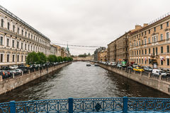 Saint Petersburg, RUSSIA - MAY 31, 2017: Embankment of St. Petersburg, rivers and canals of the old city. View of the canal from the bridge, perspective, old Stock Image