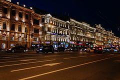 Saint Petersburg, Russia, may 2019, evening Nevsky prospect. Lights on the street lights in the city center. Traffic and road in stock photos