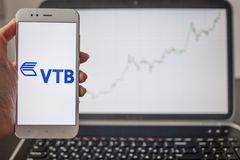 SAINT PETERSBURG, RUSSIA - MAY 14, 2019: logo of the Russian bank VTB on the background of stock charts stock image