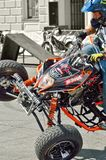The rider on the ATV shows risky stunts. royalty free stock photography