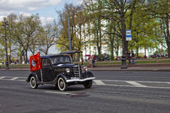 SAINT-PETERSBURG, RUSSIA - 21 MAY 2017: Parade of vintage cars. Old automobiles. Tinted photo. Stock Images