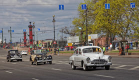 SAINT-PETERSBURG, RUSSIA - 21 MAY 2017: Parade of vintage cars. Old automobiles. Tinted photo. Stock Image