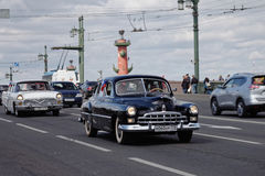 SAINT-PETERSBURG, RUSSIA - 21 MAY 2017: Parade of vintage cars. Old automobiles. Tinted photo Stock Photo