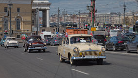 SAINT-PETERSBURG, RUSSIA - 21 MAY 2017: Parade of vintage cars. Old automobiles. Tinted photo Stock Image