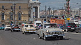 SAINT-PETERSBURG, RUSSIA - 21 MAY 2017: Parade of vintage cars. Old automobiles. Tinted photo Royalty Free Stock Images